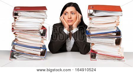 Portrait of a Bored Employee Behind a Stack of Folders Looking Up