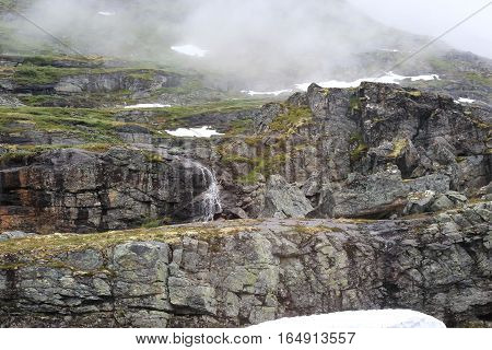 This is one of the small waterfalls which are formed annually in the mountains of Norway from snowmelt.