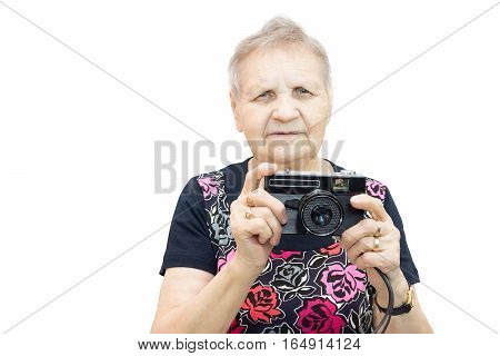 The photo shows a pensioner with a camera