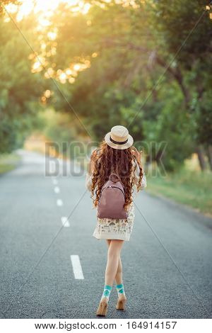Young girl traveler enjoy the travel. Happy woman walking on the road. Adventure is coming concept