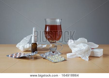 common cold or flu remedies. nasal spray, pills, tea tissues