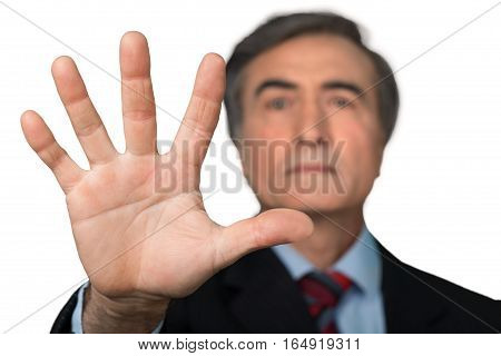 Portrait of a Senior Businessman Showing Hand / Stop Gesture