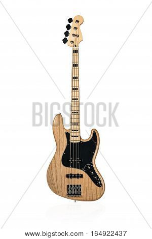 Wooden electric bass with a black plate standing vertically isolated on white background