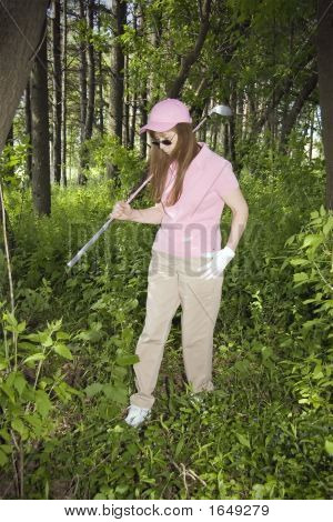 Lady Searching For Lost Golf Ball