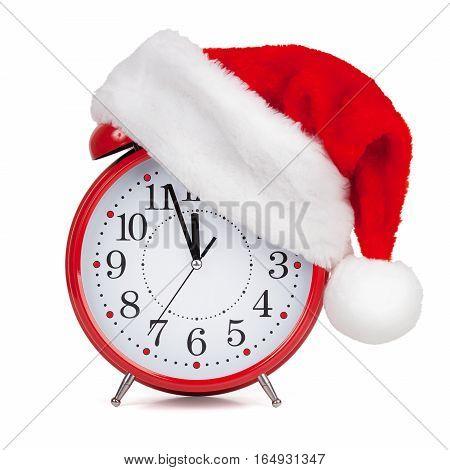 Hat Santa Claus put on a red alarm clock