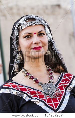 QUARTU S.E., ITALY - July 15, 2016: 30 Sciampitta - International festival of folklore - Portrait of a beautiful woman of the Cultural Association of African dance of Cagliari - Sardinia