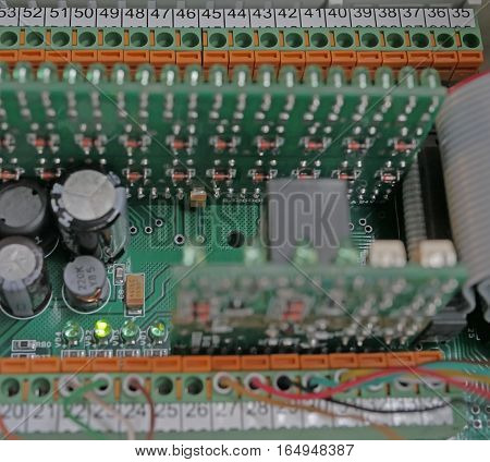 Printed Circuit Board with many electrical components.