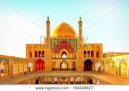 Iran, Kashan, Juma Friday mosque in the rays of the evening sun.