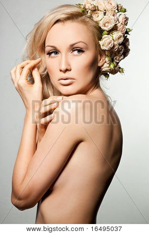 elegant fashionable woman with flowers