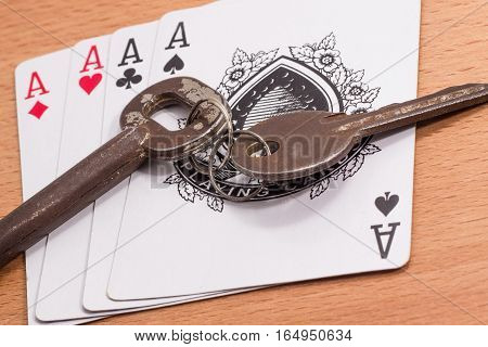 combination of four aces and the keys to the apartment