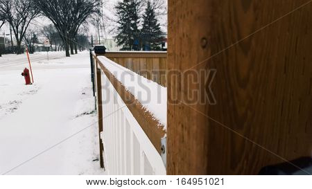 Angled Shot of a Snow Filled Railing