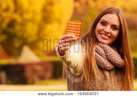 Woman With Vitamins For Autumn.