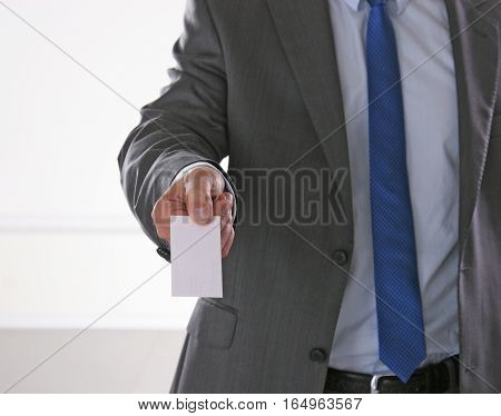 Close-up of business card in mans hand.