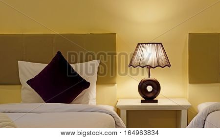 Pillow Bed And Table Lamp In Bedroom