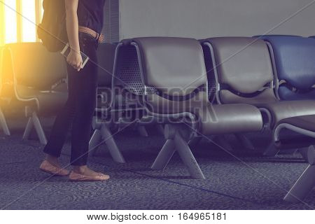 people with mobile phone are going to sit at the airport seat.