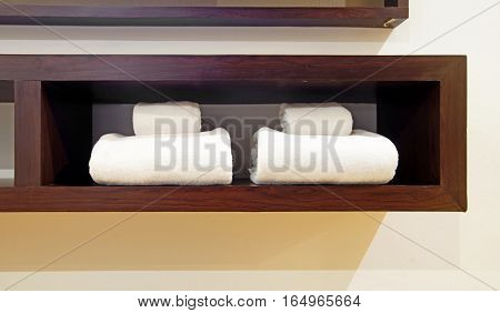 White Towels On Wooden Shelf
