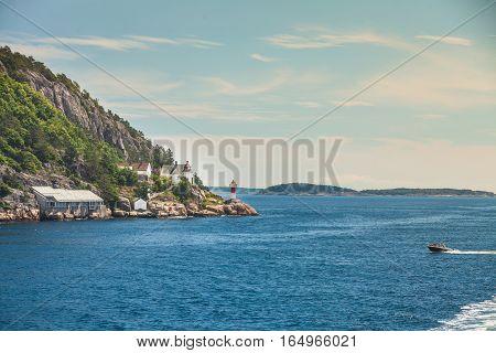 Norwegian Coastline With Lighthouse