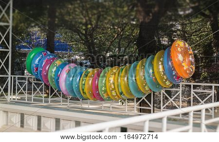 Stack of colorful inflatable swimming rings stock photo