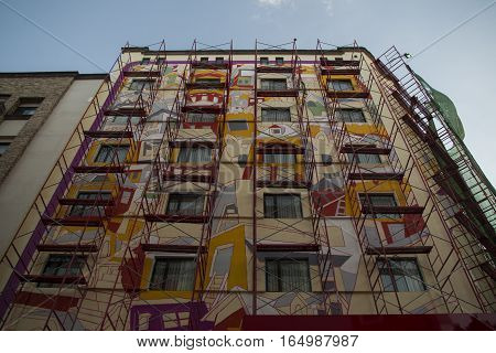 SAN JOSE, COSTA RICA - January 12: Presidente Hotel on Avenida Central, a mural is beiing painted. January 12, 2017, San Jose.