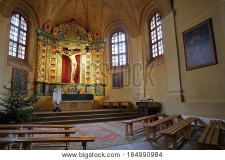 VILNIUS, LITHUANIA - JANUARY 2, 2017: The interior of the Bernardine Church with Jesus Christ Cross
