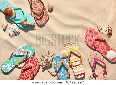 Summer background. Colorful flip flops on the sandy beach in Hawaii Kauai. Copy space for your text. Top view.