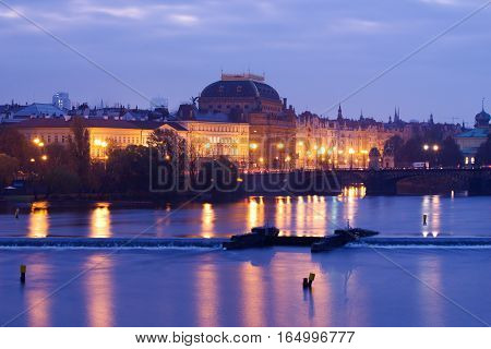 The image of the National Theatre on the River Vltava River in the capital city of Prague.