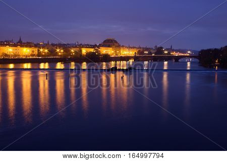 The picture of Charles bridge at the National Theatre and the river vltavu in the Prague.