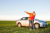image of biodiesel  - Happy young couple with their new car - JPG