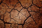 stock photo of heatwave  - A shot of cracked soil on the ground - JPG