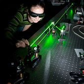 foto of laser beam  - female scientist doing research in a quantum optics lab - JPG