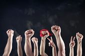 stock photo of revolt  - Clenched fists raised in protest - JPG