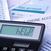 image of paycheck  - Bills and calculator displaying HELP - JPG