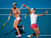 MELBOURNE, AUSTRALIA - JANUARY 28: Maria Kirilenko of Russia (R) with partner Victoria Azarenka of B