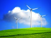 stock photo of wind-turbine  - Wind Turbines on green grass and blue sky - JPG
