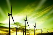 stock photo of wind-turbine  - Wind turbines farm at sunset - JPG