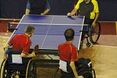 stock photo of disabled person  - Image of a disabled persons in wheelchairs playing a double table tennis game - JPG