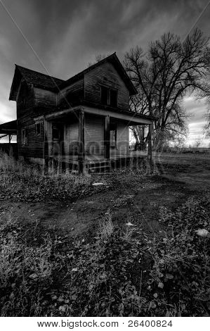 haunted house in rural Wyoming, processed HDR for dark, moody look with intentionally added grain.