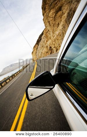 drive through mountains countryside, focus on mirror