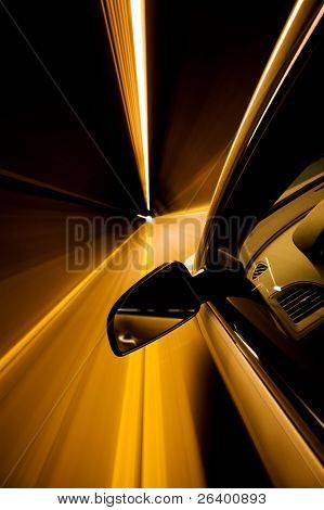 driving through tunnel with motion blur - focus on mirror