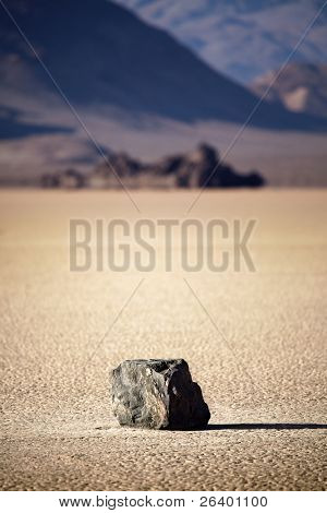 Death Valley National Park - lone rock in the middle of dry lake bed (Racetrack Playa)
