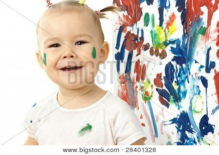 Happy little girl and her painting on a white board, isolated over white