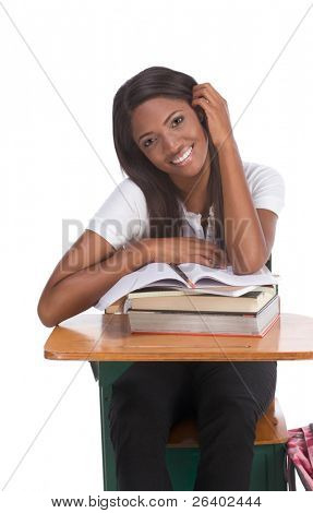 High school or college ethnic African-American female student sitting by the desk with books and copybook in class