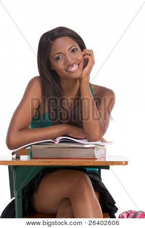 High school or college ethnic African-American female student sitting by the desk