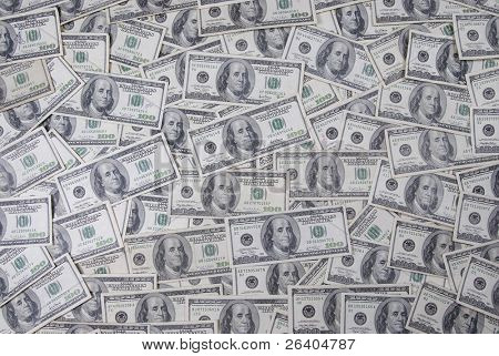 Wide view of Ben Franklin one hundred 100 dollar bills background texture graphic