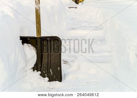 Snow Shovel In The Snowdrift