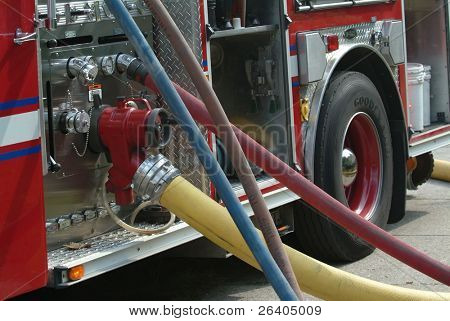 Hoses streaming from an active fire engine