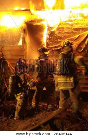 Firefighter battles house fire