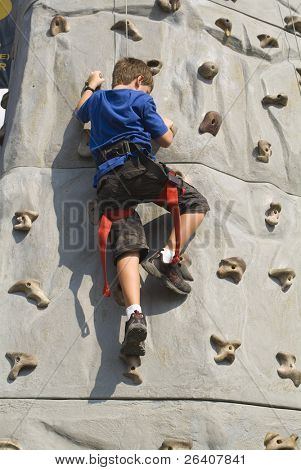 Boy climbing rock wall series