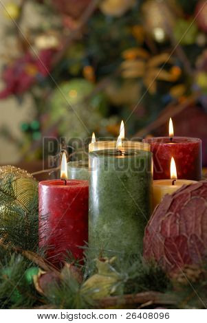 Candle lit Christmas holiday centerpiece in warm home interior