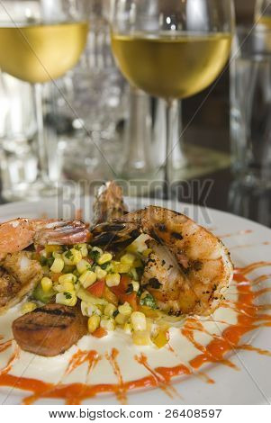 Gourmet grilled shrimp seafood with corn salsa cream sauce and white wine